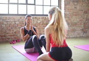 two females doing sit-ups